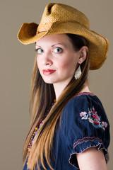 beautiful brunette in western outfit
