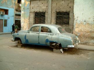 old car on bricks in havana, cuba.