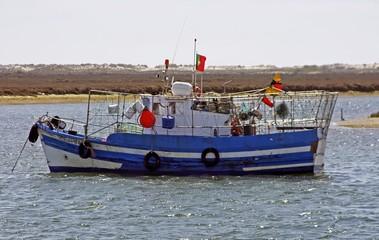 old fishing boat in harbor