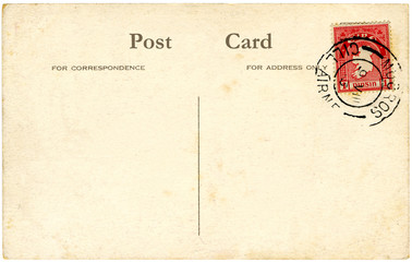 a vintage blank irish postcard with a red stamp.