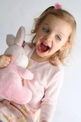 baby girl and pink bunny