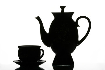 black cup and teapot
