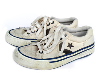 old white worn sneakers, side view