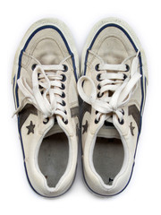 old white worn sneakers seen from above
