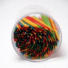 colorful toothpicks on its side