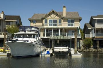 waterfront home with huge boat in dock