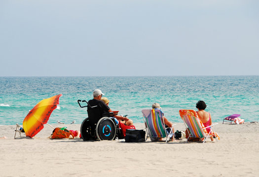 disabled traveler on the beach