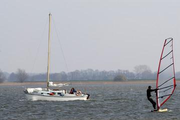 sailingboat and surfer