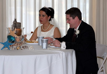 newlyweds eating at the reception