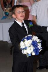 boy holding corsage
