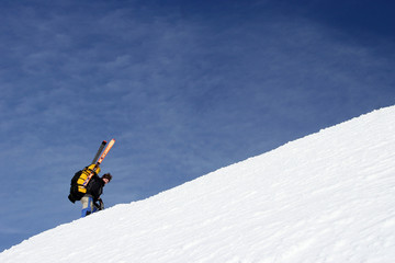 the climber rises on a crest of mountain