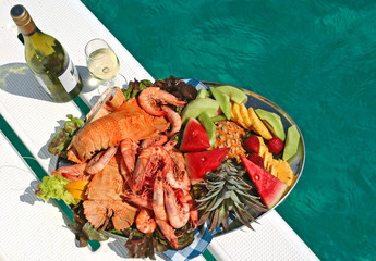 fruit and seafood platter with wine