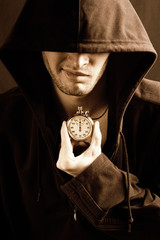 sepia picture of a handsome guy with a stopwatch