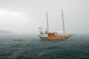 passenger yacht in the stormy ocean