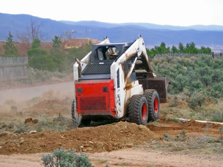 loader clearing land - widening driveway