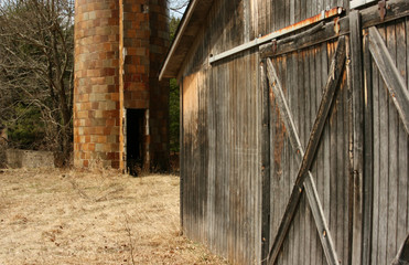 barn door with silo in background