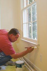 painter working inside home