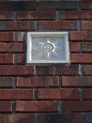medallion in brick wall