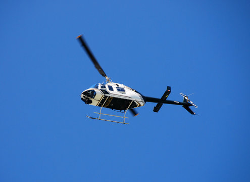 bell 206 police helicopter on patrol