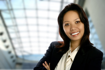 Asian business woman against modern office interior