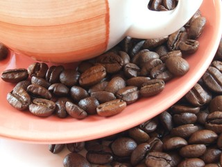 coffee beans on brown plate with cup