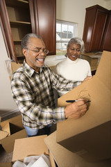 middle-aged couple with moving boxes.