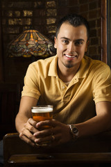 portrait of young man holding beer.