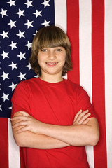 caucasian boy against american flag.
