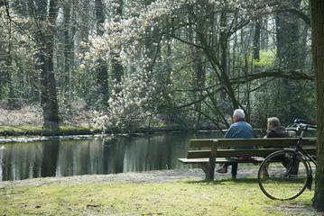 elderly couple near water