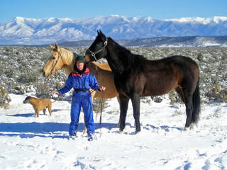 woman with her horses and dog