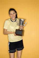 multi-racial teen girl holding trophy.