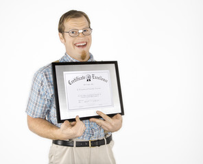 young man holding certificate and smiling.