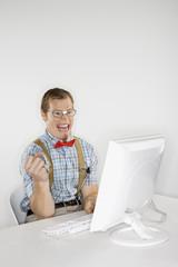 young man looking at computer monitor.
