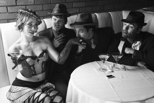 three retro businessmen wooing female.