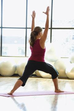 adult female doing yoga.