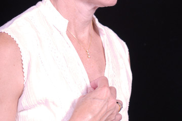 woman unbuttoning blouse