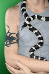 California Kingsnake draped around man's  neck.