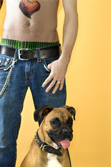 Man with Boxer dog.