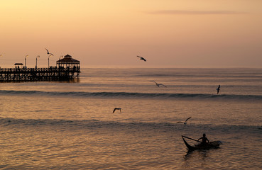 sunset at huanchaco beach in trujillo, perú