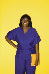 Adult female in medical uniform  holding chart.