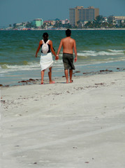 lovers walking the beach