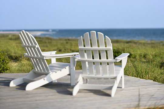 Adirondack chairs overlooking beach on Bald Head Island, North C