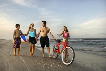 Family walking down the beach.