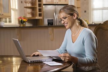 Woman paying bills on computer.