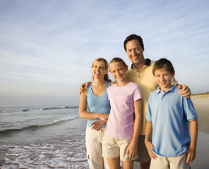 Smiling family on beach.