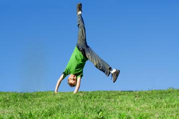 happy child playing, cartwheel