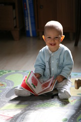 baby boy with a book