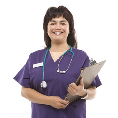 woman dressed in scrubs with clipboard.