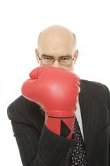 businessman wearing boxing glove.