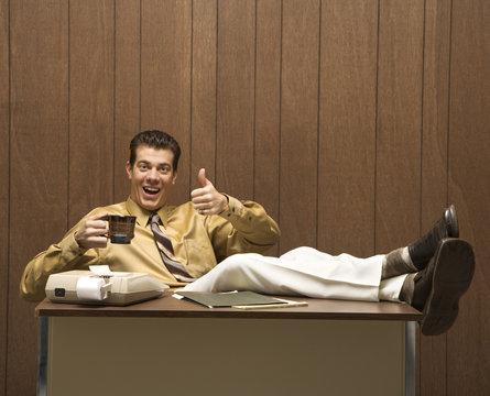 retro business scene of man at desk.